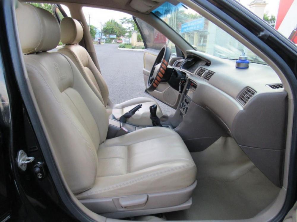 Bán xe Toyota Camry đời 1998, màu đen xe gia đình