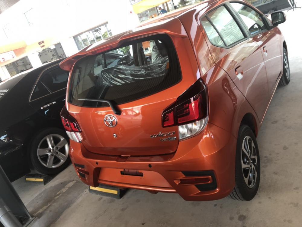 Bán Toyota Wigo 1.2MT màu cam nhập khẩu nguyên chiếc, 345tr