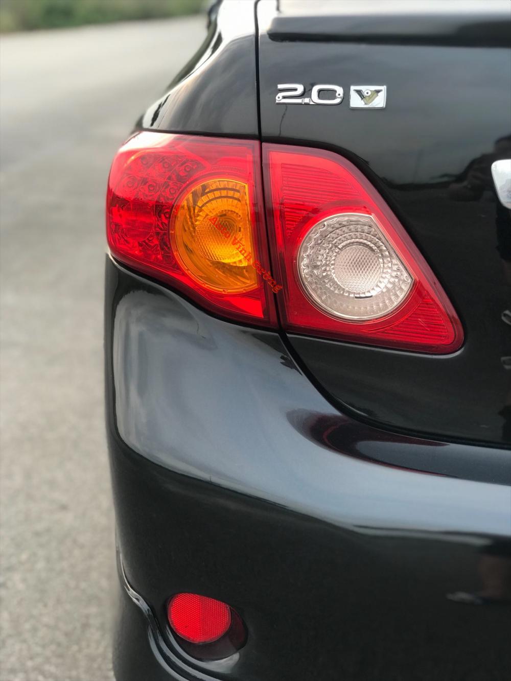 Bán Toyota Corolla Altis 2.0V đời 2010, màu đen
