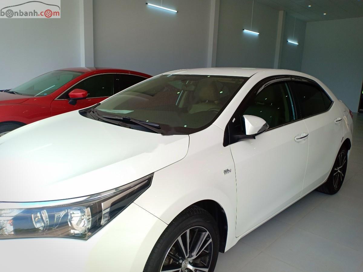Cần bán lại xe Toyota Corolla altis 1.8G đời 2015, màu trắng