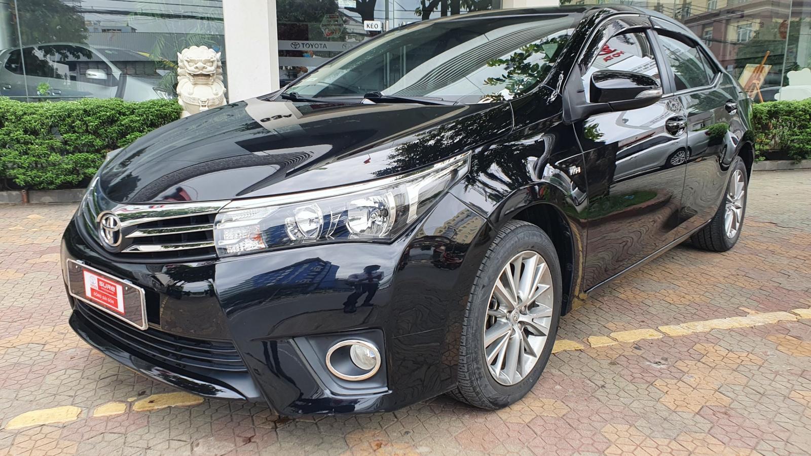 Bán ô tô Toyota Corolla altis 1.8G đời 2015, màu đen
