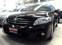 Bán xe Toyota Corolla altis 1.8 số sàn sản xuất 2009 màu đen giá 570 triệu tại Tp.HCM