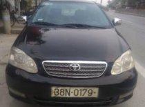 Bán xe Toyota Corolla Altis 1.3 đời 2003, màu đen giá 190 triệu tại Nghệ An