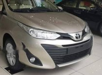 Cần bán xe Toyota Vios E CVT 2018, màu vàng giá 569 triệu tại Hà Nội