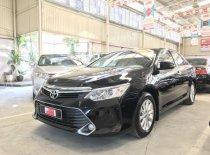Bán xe Camry 2.0E sản xuất 2015 màu đen  giá 900 triệu tại Tp.HCM