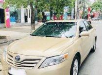 Bán Toyota Camry 2.5 LE đời 2010, màu vàng, xe nhập giá 1 tỷ 30 tr tại Tp.HCM