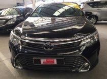 Cần bán Toyota Camry 2.0E đời 2015, màu đen giá 920 triệu tại Tp.HCM