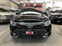 Bán Toyota Camry 2.0E đời 2015, màu đen giá 920 triệu tại Tp.HCM