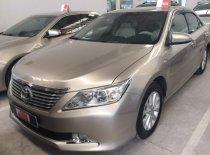 Cần bán xe Toyota Camry 2.0E đời 2013, màu nâu, số tự động giá 820 triệu tại Tp.HCM