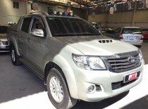 Xe Toyota Hilux 2.4E đời 2014, màu bạc, số sàn giá 560 triệu tại Tp.HCM