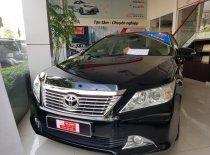 Bán Toyota Camry 2.0E 2012, màu đen, xe đẹp đã được kiểm tra chính hãng giá còn giảm cho quý khách hàng giá 770 triệu tại Tp.HCM
