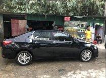 Cần bán lại xe Toyota Corolla altis năm sản xuất 2016, màu đen, chính chủ giá 720 triệu tại Hà Nội