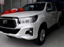 Bán Toyota Hilux 2.4E 2019, màu trắng, xe nhập, giá chỉ 695 triệu giá 695 triệu tại Tp.HCM