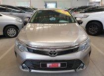Cần bán xe Toyota Camry 2.0E đời 2016, màu nâu. Vàng, giá tốt giá 910 triệu tại Tp.HCM