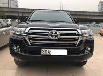 Bán Toyota Land Cruiser VX sản xuất 2016, đăng ký 2016 tên cty màu đen, nội thất kem  giá 3 tỷ 680 tr tại Hà Nội