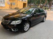Xe Toyota Camry 2.4G sản xuất năm 2011, màu đen chính chủ giá 675 triệu tại Hà Nội