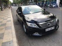 Cần bán gấp Toyota Camry 2.0E đời 2012, màu đen giá 715 triệu tại Tp.HCM