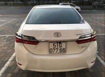 Bán ô tô Toyota Corolla Altis 1.8E năm sản xuất 2018, màu trắng  giá 719 triệu tại Tp.HCM