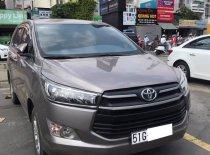Cần bán gấp xe Toyota Innova 3/2017 màu xám ghi giá 652 triệu tại Tp.HCM