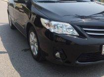 Bán xe Corola Atits AT 1.8G màu đen năm 2014, xe rất đẹp giá 555 triệu tại Nghệ An