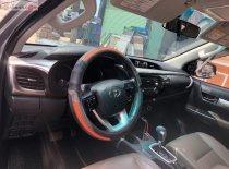 Cần bán lại xe Toyota Hilux 2016, màu bạc, nhập khẩu   giá 675 triệu tại Tp.HCM