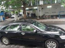 Bán Toyota Camry 2.4G năm sản xuất 2011, màu đen giá 700 triệu tại Tp.HCM