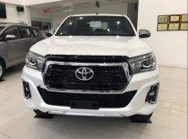 Cần bán Toyota Hilux đời 2019, màu trắng, nhập khẩu, giá tốt giá 670 triệu tại Tp.HCM