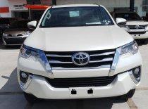 Bán xe Toyota Fortuner máy dầu tự động 1 cầu, mới 100% giao ngay đủ màu giá 1 tỷ 26 tr tại Tp.HCM