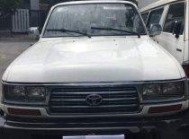 Bán Toyota Land Cruiser sản xuất 1996, màu trắng, nhập khẩu, 7 chỗ giá 140 triệu tại Tp.HCM