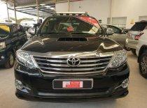Cần bán xe Toyota Fortuner 2.5G đời 2015, màu đen, xe gia đình, ít đi lại full option giá 850 triệu tại Tp.HCM