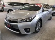 Cần bán Toyota Corolla altis năm 2015, màu bạc giá 670 triệu tại Tp.HCM