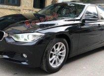 Cần bán xe BMW 320i sản xuất 2012, model 2013 màu đen giá 720 triệu tại Hà Nội