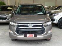 Cần bán xe Toyota Innova 2.0E đời 2018, màu nâu, xe đẹp long lanh, full option giá 750 triệu tại Tp.HCM