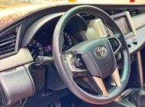 Cần bán lại xe Toyota Innova sản xuất 2017, màu bạc số sàn, giá tốt giá 680 triệu tại Bình Dương