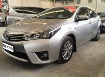 Bán Toyota Corolla Altis 1.8G sản xuất 2015, màu bạc giá 670 triệu tại Tp.HCM