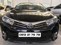 Bán ô tô Toyota Corolla Altis 2.0V đời 2014, màu đen giá 690 triệu tại Tp.HCM
