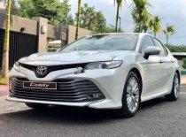 Bán Toyota Camry sản xuất năm 2019, màu trắng, nhập khẩu   giá 1 tỷ 243 tr tại Bình Dương