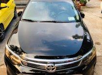 Cần bán Toyota Camry 2016, màu đen, đã đi 54.000km  giá 905 triệu tại Tp.HCM