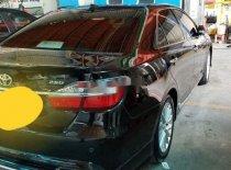 Cần bán gấp Toyota Camry đời 2016, màu đen xe nguyên bản giá 940 triệu tại Tp.HCM