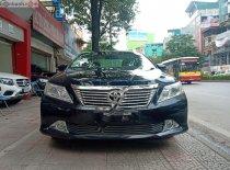Bán xe Toyota Camry 2.0E 2013, màu đen ít sử dụng, giá chỉ 680 triệu giá 680 triệu tại Hà Nội