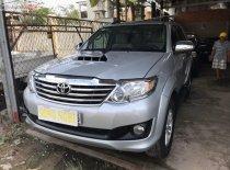 Cần bán xe Toyota Fortuner đời 2014, màu bạc xe nguyên bản giá 725 triệu tại Tiền Giang