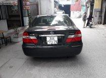 Cần bán xe Toyota Camry đời 2003, màu đen xe máy chạy êm giá 285 triệu tại Hà Nội