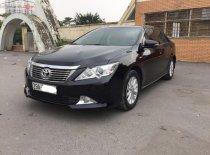 Cần bán gấp Toyota Camry 2.0E năm 2013, màu đen giá 696 triệu tại Hà Nội