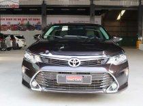 Bán Toyota Camry 2.0E năm 2019, màu nâu giá 980 triệu tại Tp.HCM