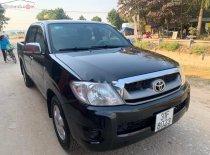 Cần bán lại xe Toyota Hilux 2.5E 4x2 MT đời 2010, màu đen, xe nhập chính hãng giá 289 triệu tại Hà Nội