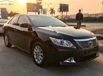 Cần bán lại xe cũ Toyota Camry 2.0E năm 2013, màu đen, giá 660tr giá 660 triệu tại Nam Định