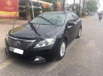 Cần bán lại xe Toyota Camry 2.0E năm sản xuất 2014, màu đen giá 705 triệu tại Hà Nội
