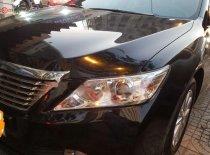 Cần bán Toyota Camry 2.0E năm sản xuất 2014, màu đen xe gia đình giá 726 triệu tại Tp.HCM