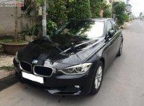 Cần bán gấp BMW 3 Series 320i 2013, màu đen, nhập khẩu, giá tốt giá 700 triệu tại Cần Thơ