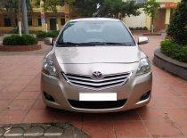 Tôi cần bán chiếc xe ô tô TOYOTa Vios 1.5E màu ghi vàng SX 2014 giá 298 triệu tại Hà Nội